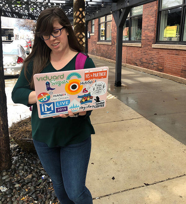 stephanie walking with laptop